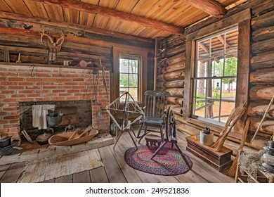"""LARGO, FLORIDA - JANUARY 14, 2015 : Interior of the historic McMullen-Coachman Log House in the Pinellas County Heritage Village. It is a typical Florida """"Cracker"""" log home of the pioneer period."""
