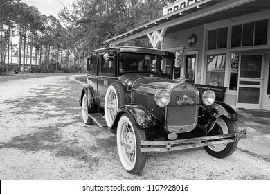 Largo, Florida, USA Photo taken on: 02/09/2018 Black and white photo of a classic Ford model A car (1927-31) in front of a vintage grocery store. The Photo was taken at Heritage Village.