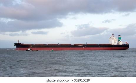 Largo ore bulk carrier leaving the Port of Rotterdam.