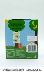 Largs, Scotland, UK - February 04, 2019: Cardboard box containing four pouches Heinz by nature branded children's food with recycling guidelines displayed on the rear inline with current UKinitiatives