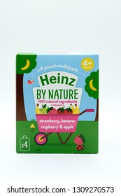 Largs, Scotland, UK - February 04, 2019: Cardboard box containing four pouches Heinz by nature branded children's food in only partial tecyclable packaging.
