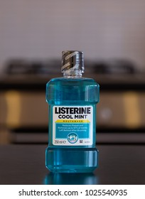 Largs, Scotland, UK - February 14, 2018: A bottle of listerine mouthwash in cool mint flavour and on a kitchen work top.