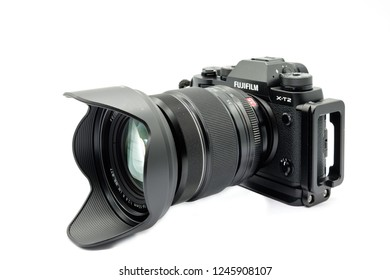 Largs, Scotland, UK - November 22, 2018: Fujifilm X-T20 Camera body, generic 'L' bracket and Fuji's 126-55mm lens being the bigger brother to the X-T20. This camera has the new X-Trans™* CMOS III sens