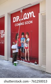 LARISSA, GREECE-31 JULY 2017,Worker painting wall and preparing DP...AM or  Du Pareil au meme, Dpam, children clothing shop for opening