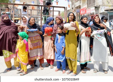 LARKANA, PAKISTAN - APR 22: Residents of Miro Khan are holding protest demonstration against high handedness of Police Department, at Jinnah Bagh roundabout in Larkana on April 22, 2018.
