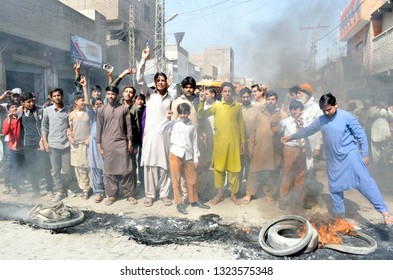 LARKANA, PAKISTAN - FEB 25: Residents of Bilawal Colony are burns tyres and block road as they are holding protest against electricity load shedding in their area, on February 25, 2019 in Larkana.