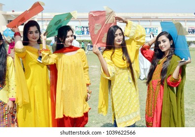 LARKANA, PAKISTAN - MAR 05: Students of Chandka Medical College are celebrating Basant Festival held at College premise on March 05, 2018 in Larkana.