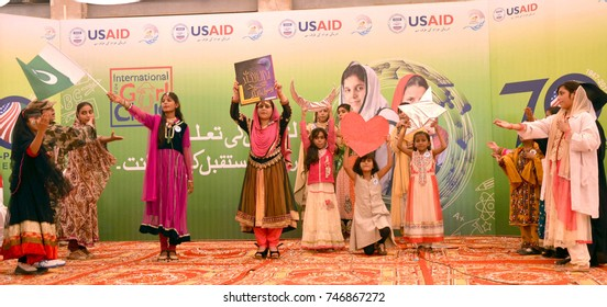 LARKANA, PAKISTAN - NOV 01: Students are performing a tableau during function in  connection of International Child Girl Day, arranged by USAID in Dera Allah Yar on  November 01, 2017 in Larkana.