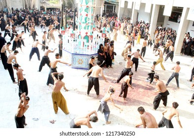LARKANA, PAKISTAN - OCT 30: Devotees mourner of Imam Hussain (A.S) are scorching themselves by knives during Chehlum (40th Day) of Imam Hussain (A.S) procession, on October 30, 2018 in Larkana .