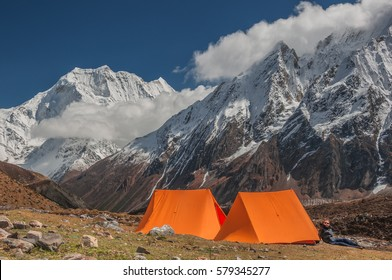 Larkya Phedi camp, Manaslu Circuit trek-October 13, 2009: A trekker at rest at his tent after the ascent from Samdo village to Larky camp, Manaslu Himal, Gorkha district, Nepal Himalayas, Nepal