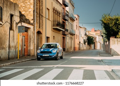L'armentera, Spain - May 18, 2018: Blue Mini Cooper Countryman Driving  In Old Narrow Spanish Street. Car Of Second Generation, F60. Mini Countryman is a subcompact crossover SUV.