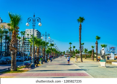 LARNACA, CYPRUS, AUGUST 15, 2017: People are enjoying a sunny day on Finikoudes promenade in Larnaca, Cyprus