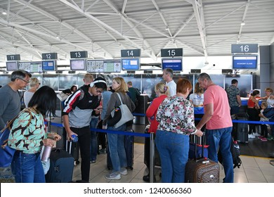 Larnaca, Cyprus - November 6. 2018. Passengers about check-in counters in airport building