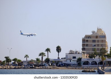 Larnaca, Cyprus - October 19 2016, A Thomas Cook airplane landing in LCA Larnaca airport over the  beach and promenade