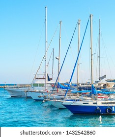 Larnaca marina with yachts and sailboats in bright sunshine daytime, Cyprus