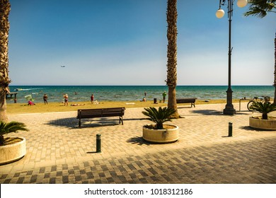 Larnaka City, Cyprus island - September 4, 2016: A view at Finikoudes Beach from Palm tree promenade