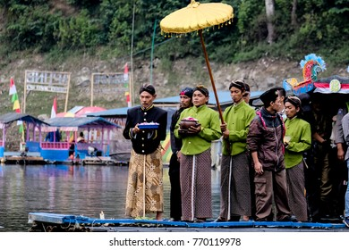 Larungan is a traditional culture in Wonosobo Central Java Indonesia, thats a man was throw flowers in a Menjer Laketo pray god to safe the earth and brings blessing to local peoples. 27 July 2017