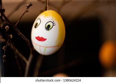 Larvik, Norway - April 21st 2019: Drawn on face on egg. Easter tradition.