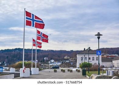 Larvik, Norway - April 5, 2015: Traditional buildings. Name of the fjord - Larviksfjorden. Town in Vestfold county, Norway. Larvik harbor in spring, Norway
