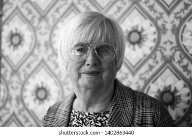 Larvik, Norway - February 27th 2019: 70s portrait of old woman, in glasses.
