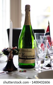 Larvik, Norway - May 17th: Bottle of champagne, on a table decorated for the national day.