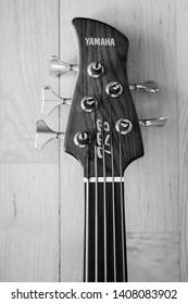 Larvik, Norway - May 26th 2019: Yamaha five string fretless bass guitar.