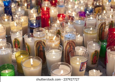 LAS CHOAPAS, MEXICO - DECEMBER 12, 2014: Hundreds of religious candles featuring the Virgin Mary are placed on a Catholic church floor in Las Choapas, Veracruz to commemorate Our Lady of Guadalupe