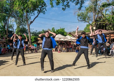 Las Condes, Region Metropolitana, Chile - October 15, 2017: Young men dancing in custom