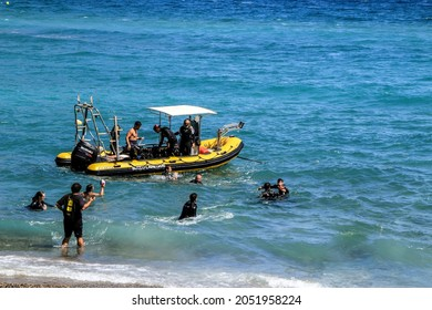 Las Negras, Almeria, Spain- September 5, 2021: Divers getting on the boat to go snorkeling on Las Negras beach on a sunny day of summer