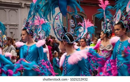 LAS PALMAS DE GRAN CANARIA, SPAIN - FEBRUARY 13: Spectators and participants enjoy Children Carnival Parade along city streets,  February 13, 2018 in Las Palmas de Gran Canaria, Spain