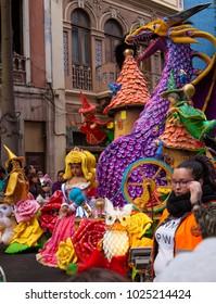 LAS PALMAS DE GRAN CANARIA, SPAIN - FEBRUARY 13: Spectators and participants enjoy Children Carnival Parade along city streets, Children Carnival Queen, February 13, 2018 in Las Palmas de Gran Canaria