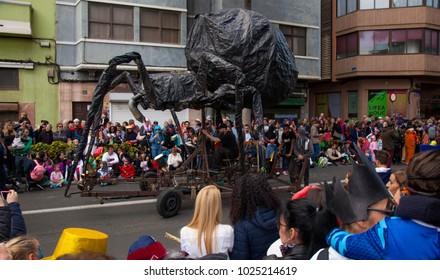 LAS PALMAS DE GRAN CANARIA, SPAIN - FEBRUARY 13: Spectators and participants enjoy Children Carnival Parade along city streets, giant animals, February 13, 2018 in Las Palmas de Gran Canaria, Spain