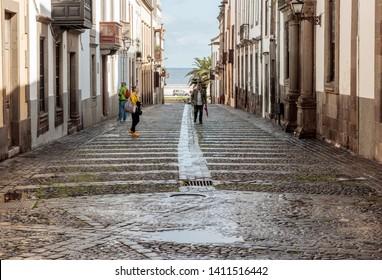 LAS PALMAS de GRAN CANARIA, CANARIAS, SPAIN - NOVEMBER 19, 2018: View of medieval buildings and the sea on Calle Los Balcones