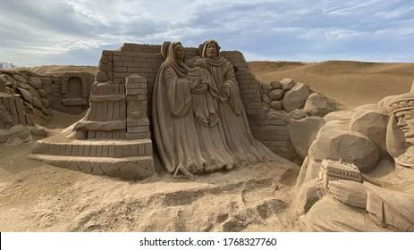 LAS PALMAS DE GRAN CANARIA, SPAIN - DECEMBER 25, 2019: Belen de Arena, Nativity scenes made of sand, On Las Canteras beach.