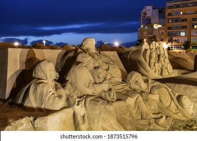 Las Palmas de Gran Canaria, Spain - Decemeber 06, 2020 Belén de Arena de Las Canteras (Sand Art Nativity) at night, exhibition of Christmas nativity sand sculptures on Las Canteras beach, Gran Canaria
