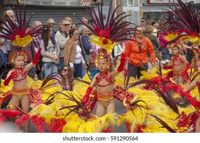 Las Palmas de Gran Canaria, Spain - February, 28: Spectator and participants in bright costumes enjoy Children Carnival Parade, February 28, 2017  in Las Palmas de Gran Canaria, Spain