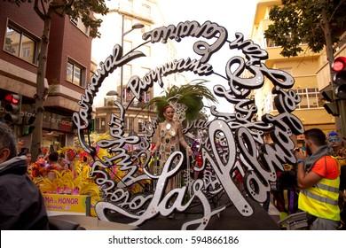 Las Palmas de Gran Canaria, Spain - March 04: Carnival Dame greets the public at Main Carnival Parade, March 4, 2017  in Las Palmas de Gran Canaria, Spain