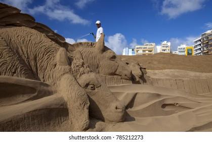LAS PALMAS DE GRAN CANARIA, SPAIN - DECEMBER 31: Belen de Arena, Nativity scenes made of sand, on Las Canteras town beach, December 31, 2017  in Las Palmas de Gran Canaria, Spain