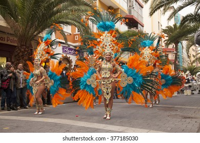 """LAS PALMAS - February 13: Music and dancer groups in colorful costumes take part in the Las Canteras beach carnival parade """"Carnaval al Sol"""", February 13, 2016 in Las Palmas, Gran Canaria, Spain"""
