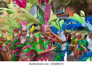 LAS PALMAS - February 17: Participants in bright costumes take part in Children carnival  parade, February 17, 2015 in Las Palmas, Gran Canaria, Spain