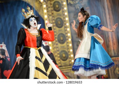 LAS PALMAS, SPAIN -FEBRUARY 10: Unidentified dancers from Canary Islands, playing Alice's Adventures in wonderland, during Junior Queens Gala 's opening show on February 10, 2013 in Las Palmas, Spain.