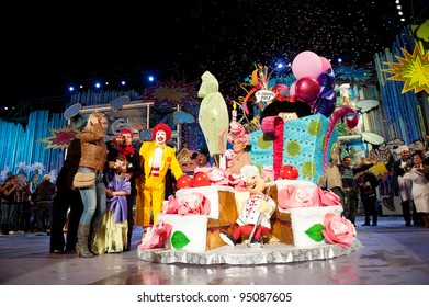 LAS PALMAS, SPAIN- FEBRUARY 12: First prize to Aymara del Pino Rueda, from Canary Islands, onstage  surrounded with unidentified people during The Junior Queen on February 12, 2012 in Las Palmas, Spain