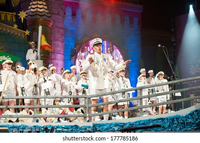 LAS PALMAS , SPAIN - FEBRUARY 19: Director David Zurita (in front) in Los Leganosos from Canary Islands, performing during the Murgas Contest on February 19, 2014 in Las Palmas, Spain