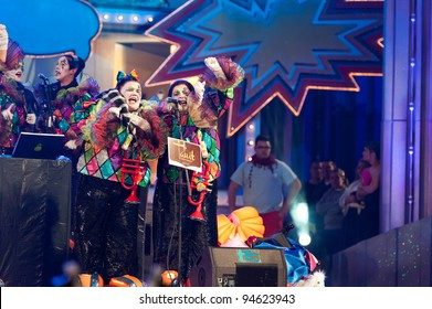 LAS PALMAS , SPAIN - FEBRUARY 6: Unidentified members from Murga Las Lady's Chancletas, from Canary Islands, perform during 1st, round of the Murgas contest on February 6, 2012 in Las Palmas, Spain