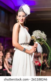 LAS PALMAS, SPAIN - MARCH 12, 2015: A model walks the runway wearing a wedding dress from designer Nieves Barroso during Gran Canaria Moda Calida 2016 Bridal Collection at Museum Nestor.