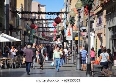 LAS PALMAS, SPAIN - NOVEMBER 30, 2015: People visit Triana shopping street in Las Palmas, Gran Canaria, Spain. Canary Islands had record 12.9 million visitors in 2014.