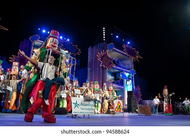 LAS PALMAS ,SPAIN-FEBRUARY 6:Conductor David Zurita with unidentified members from Murga Los Leganosos, from Canary Islands, perform during the  Murgas contest on February 6, 2012 in Las Palmas,Spain