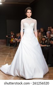 LAS PALMAS, SPAIN-MARCH 13, 2015: A model walks the runway wearing a wedding dress from designer Ogadenia Diaz during Gran Canaria Moda Calida 2016 Bridal Collection at Museum Nestor.