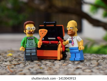 Las Pinas, Philippines - May 30, 2018: Ned Flanders and Homer Simpsons Lego Minifigures out on a BBQ - Image