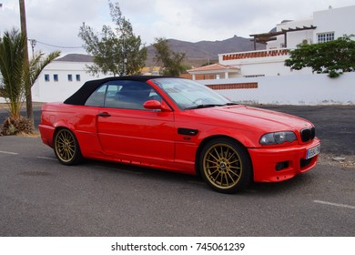 Las Playitas, Fuerteventura, Canary Islands, Spain - October 22, 2017: Red BMW 318 cabrio parked on e public parking lot in the city of Las Playitas.